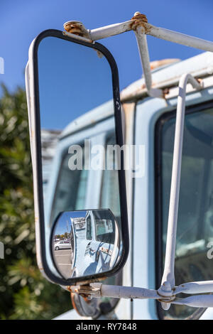 Side-view mirror on old truck; California, USA - Stock Image