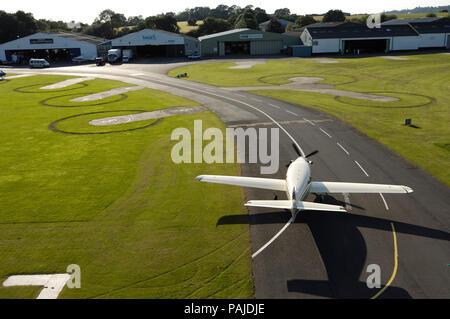 Farnborough F1 Kestrel taxiing with hangars behind - Stock Image
