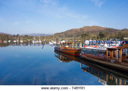 Boats moored at the pier at Ambleside on Lake Windermere, Cumbria, England, UK - Stock Image