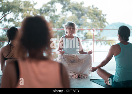 Group of people meditating in the morning. Yoga retreat in Mexico. - Stock Image