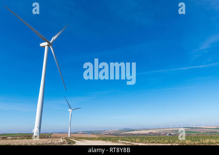 Wind turbines.Wind turbines generating electricity with blue sky energy conservation concept. - Stock Image