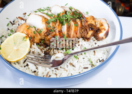 Sticky BBQ Chicken served with wild rice. - Stock Image