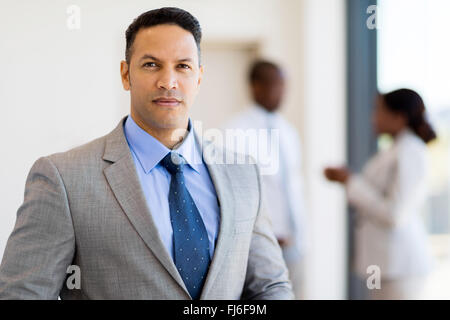 portrait of successful businessman in modern office - Stock Image