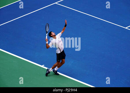 Flushing Meadows, New York - September 3, 2018: US Open Tennis:  Number 6 seed Novak Djokovic serving to serving to Joao Sousa of Portugal during their fourth round match at the US Open in Flushing Meadows, New York.  Djokovic won in straight sets. Credit: Adam Stoltman/Alamy Live News - Stock Image