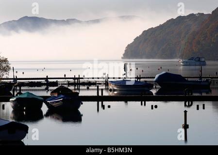 Fog sits over Loch Lomond near Balmaha as Autumn arrives - Stock Image