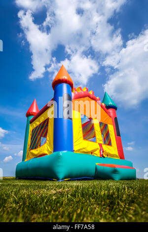 Bounce house inflatable jump castle in yard. - Stock Image