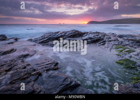 Sunset over Trevose Head from the rocky shores of Booby's Bay, Cornwall, England. Summer (July) 2017. - Stock Image