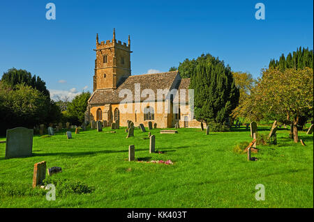 The small parish church of St George in the Cotswold village of Didbrook on a late summer afternoon - Stock Image