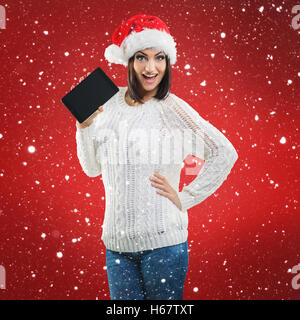 Santa Women, with tablet - Stock Image