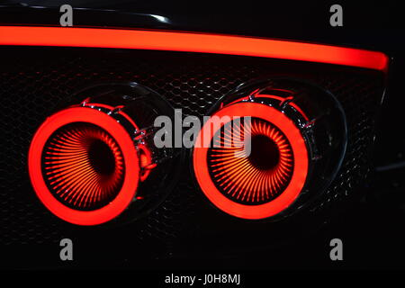 Manhattan, New York, USA. April 12, 2017.  Spyker C8 Preliator illuminated red tail lights are seen close-up at - Stock Image
