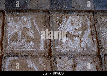 removal of original floor tiles in an old farmhouse due to damp rising up through floor from below zala county hungary - Stock Image