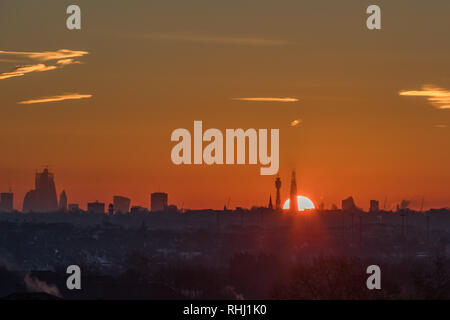 London, UK. 3rd Feb 2019. View from Wembley Park of the London Skyline. Sun rising behind the Shard and BT Tower. Credit: amanda rose/Alamy Live News - Stock Image