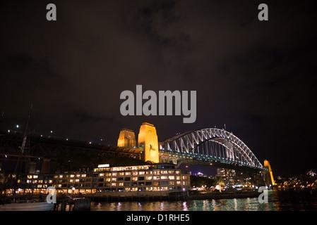 SYDNEY, Australia - SYDNEY, Australia - The Sydney Harbour Bridge at night, as seen from Circular Quay. Copyspace - Stock Image