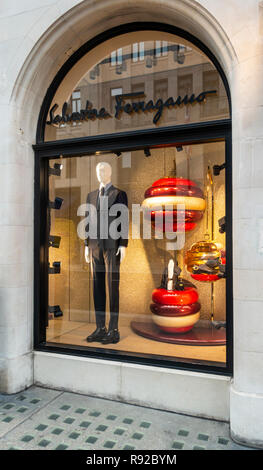 Shop window of the Salvatore Ferragamo Italian fashion store in Old Bond Street, Mayfair, London, England, UK featuring a man's suit and accessories,  - Stock Image