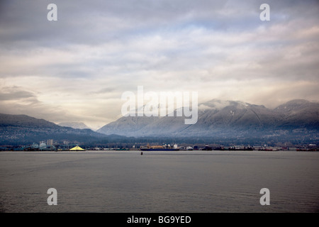 North Shore Mountains covered in snow and Burrard Inlet, Vancouver, BC, Canada - Stock Image
