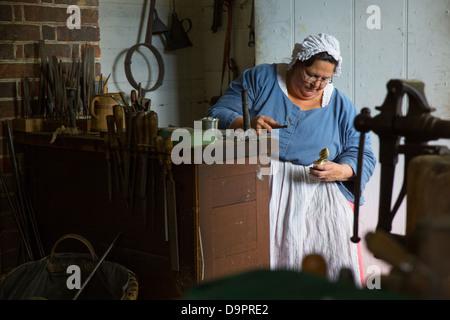 Woman in shop at Colonial Williamsburg, Virginia, USA - Stock Image