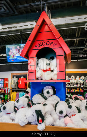 inside a store selling carton character snoopy dog merchandise and gifts - Stock Image