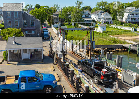 A Chappy Ferry docks in downtown Edgartown, Massachusetts after the short crossing from Chappaquiddick Island. - Stock Image