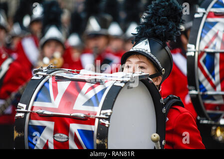 Seabreeze High School Marching 100 band from Florida, USA, at London's New Year's Day Parade, UK. Female band member, drummer - Stock Image