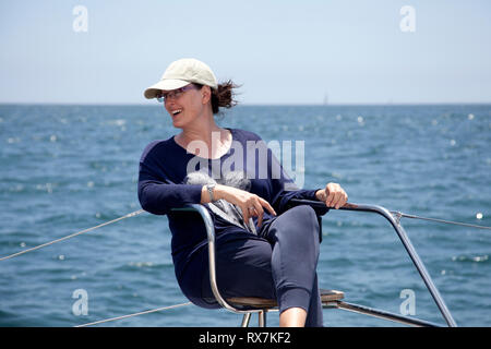 Woman On Deck Seat on Catamaran at Sea in Table Bay, Cape Town, South Africa - Stock Image