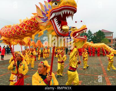 Ji'an, China's Jiangxi Province. 16th Feb, 2019. Villagers perform dragon dance to greet the Lantern Festival in Huagaishan Village of Taihe County in Ji'an, east China's Jiangxi Province, Feb. 16, 2019. The Lantern Festival this year falls on Feb. 19. Credit: Deng Heping/Xinhua/Alamy Live News - Stock Image