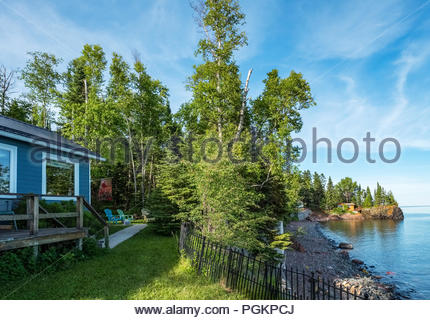 Cabin is perched on a cliff with sweeping views of Lake Superior, near Grand Marais, Minnesota, USA. - Stock Image