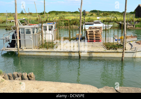 oyster boat in La Tremblade site ostriecole  Oyster farming harbour Charente Maritime France - Stock Image
