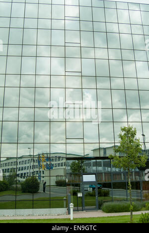 Refections in windows of modern office building - Stock Image