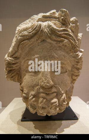 Limestone Head of God Hadad. 1st Century. Jordan Archeological Museum - Stock Image