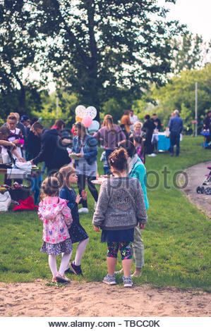 Adults and children on a park during a - Stock Image