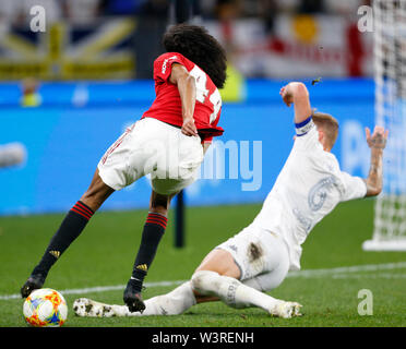 Optus Stadium, Burswood, Perth, W Australia. 17th July 2019. Manchester United versus Leeds United; pre-season tour; Tahith Chong of Manchester United is fouled in the box by Liam Cooper of Leeds United Credit: Action Plus Sports Images/Alamy Live News - Stock Image