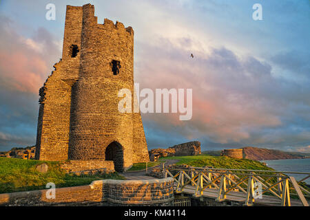 The remains of the ruined castle in golden hour light. It was built in response to the First Welsh War in the late - Stock Image