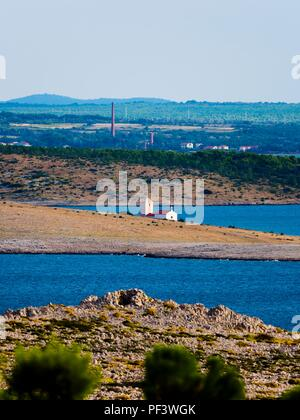 Church on small island Zecevo near Nin in Croatia view from Smokvica on Pag island - Stock Image