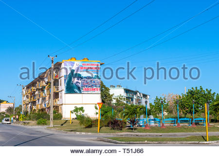 Fidel Castro billboard on an apartment building during the day - Stock Image