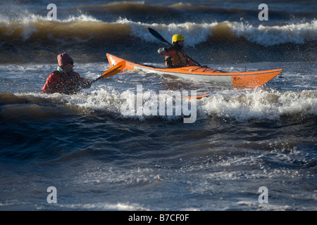 kayakers in waves - Stock Image