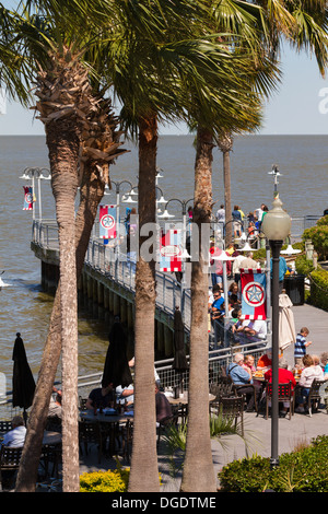Tourists eating outside at Kemah boardwalk amusement park Texas USA - Stock Image