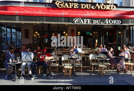 Typical Parisian cafe du Nord located next Gare du Nord railway station in Paris, France. - Stock Image
