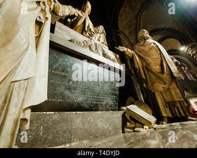 Paris, France - Apr 15, 2018: Tomb inside Notre-Dame Cathedral with toursit a few minutes before the cathedral's fire started and spire and roof collapsed with significant damage  - Stock Image