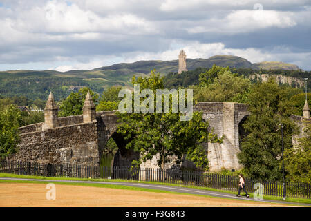 Stirling Old Bridge and The National Wallace Monument on Abbey Craig, Stirling in Scotland - Stock Image