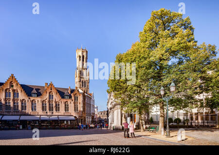 25 September 2018: Bruges, Belgium - Burg Square, looking towards the Market Square and the Belfry Tower on a sunny afternoon. - Stock Image