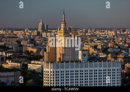 View of Russian Federation Government House (the White House) and a Stalin era wedding cake tower, Moscow, Russia - Stock Image