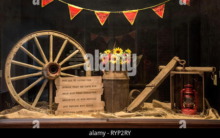 Western display with a religious setting in a Baptist Church, North Florida. - Stock Image