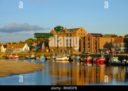 View of the Quay at Wells next the sea showing the old maltings complex. - Stock Image