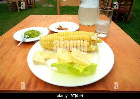 Choclo con queso dish in a restaurant, Urubamba, Cuzco, Peru - Stock Image