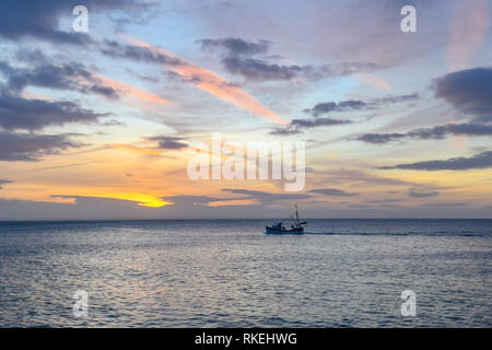 Mousehole, Cornwall, UK. 11th Feb, 2019. UK Weather. Colourful sunrise at Mousehole this morning, for this fishing boat returning to Newlyn in the early morning. No sign of the wind from the recent stork Erik. Credit: Simon Maycock/Alamy Live News - Stock Image