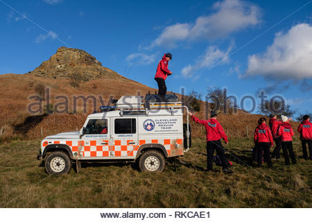 Roseberry Topping, near Great Ayton on the North York Moors, North Yorkshire, UK. 10th February 2019. Cleveland Mountain Rescue Team were called to assist a woman who had injured herself walking down Roseberry Topping hill this afternoon. After providing medical assistance at the scene the Team carried her on one of their stretchers before transporting her across fields in one of their Land Rover vehicles to a waiting ambulance. She was then taken to James Cook Hospital at Middlesbrough for treatment. Credit: ClevelandMRT/Alamy Live News - Stock Image
