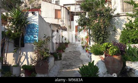 Old narrow street with stone arch at Maroulas, Rethimno, Crete, Greece - Stock Image