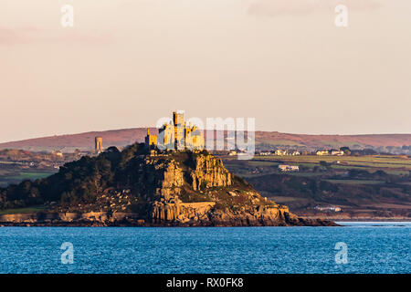 Late afternoon golden sun on St Michael's Mount, Cornwall, UK - Stock Image