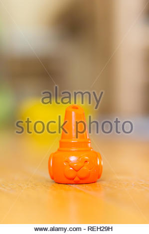 Poznan, Poland - October 10, 2018: Orange dog shaped crayon standing on a wooden floor in soft focus - Stock Image