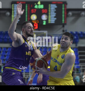 Opava, Czech Republic. 16th Jan, 2019. Amit Simhon of Hapoel, left, and Rostislav Dragoun of Opava fight for a ball during the Group B, 11th round of the Champions League match BK Opava vs Hapoel Holon in Opava, Czech Republic, January 16, 2019. Credit: Jaroslav Ozana/CTK Photo/Alamy Live News - Stock Image